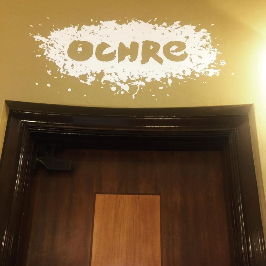 Ochre door sign